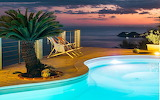 Mediterranean sunset and pool overlooking sea
