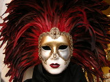 ^ Venetian mask , Italy - photo by John Ecker