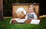 Child, suitcase, boy, grass, book, toy, bunny