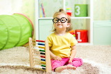 Girl, carpet, child, glasses, sitting, toys, room