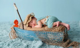 beautiful baby sleeping on a boat