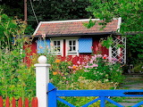 Beautiful wooden cottage with flower garden