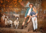 couple with goats