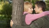Boy girl tree hug
