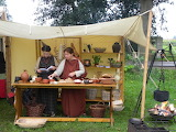 women cooking outdoors in roman outfit