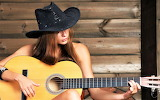Cowgirl playing guitar