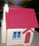 Front of Tiny Flowered Cottage by JoAnn Jacot