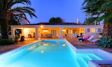private pool and villa at dusk