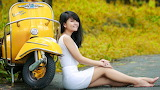 Asian girl in yellow scooter