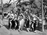 Hula girls in the Hawaiian Village on June 5, 1934. © Chicago Tr
