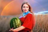 Beautiful-girl-red-dress-rainbow-wheat-field-watermelon-summer