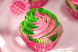 ^ Pink and green swirled cupcakes