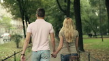 happy-young-couple-walking-in-the-park