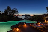 Luxury pool and seaview gardenterrace at night