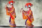 Okinawan dancers in traditional Yotsudake headdress