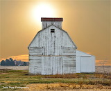 Barn with turrett sun in background