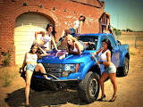 girls posing with truck