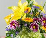 ^ Yellow stargazer lily, hydrangea, roses, purple aster, gerbera