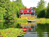 Lake house with red roof