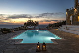 Rustic stone villa and pool at sunset, Paros, Greek islands