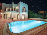 Modern Greek villa, pool and terrace at night