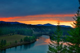 Sunset over river after storm Montana