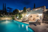 Modern white Mediterranean villa and pool at night