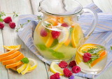 Carafe glass flavored water whit fruit-depositphotos