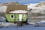 Greenland green wooden cottage