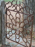 Garden gate made of old horse shoes