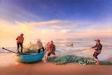 Vietnamese fishermen pulling in nets