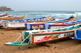 I love the colorful fishing boats that line the beaches of Dakar