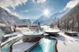 Winter-futuristic oasis of thermal water in Tyrol mountains
