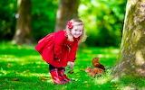 Girl, child, nature, red coat, squirrel, tree, smile