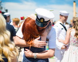 Navy veteran hugs his woman