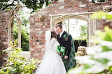 Bride and groom in kilt among the ruins