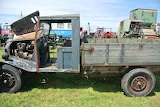 Green-and-brown-old-truck-opened-engine-truck