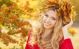 Beautiful blonde girl with head decorated of leaves