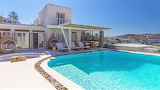 Beautiful white Greek island villa and pool