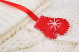 Red mitten with white knitting
