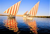 Candy-striped sails Nile River Egypt