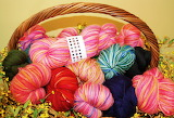 Yarn and flowers in a basket