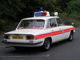 British white Triumph car
