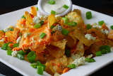 ^ Kettle chips smothered in cheddar-jack cheese, bleu cheese, gr