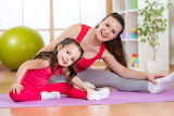 Mother and daughter exercising