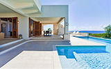 Luxury white Mediterranean villa and pool by the sea