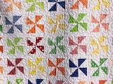 ^ Pinwheel quilt