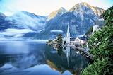Wisps of morning fog and ducks swimming to Hallstatt Austria