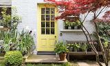 Yellow door entrance photo credit: Joakim Blockstrom