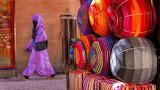 Woman-in-purple-dress-walking-at-the-marrakesh-markets